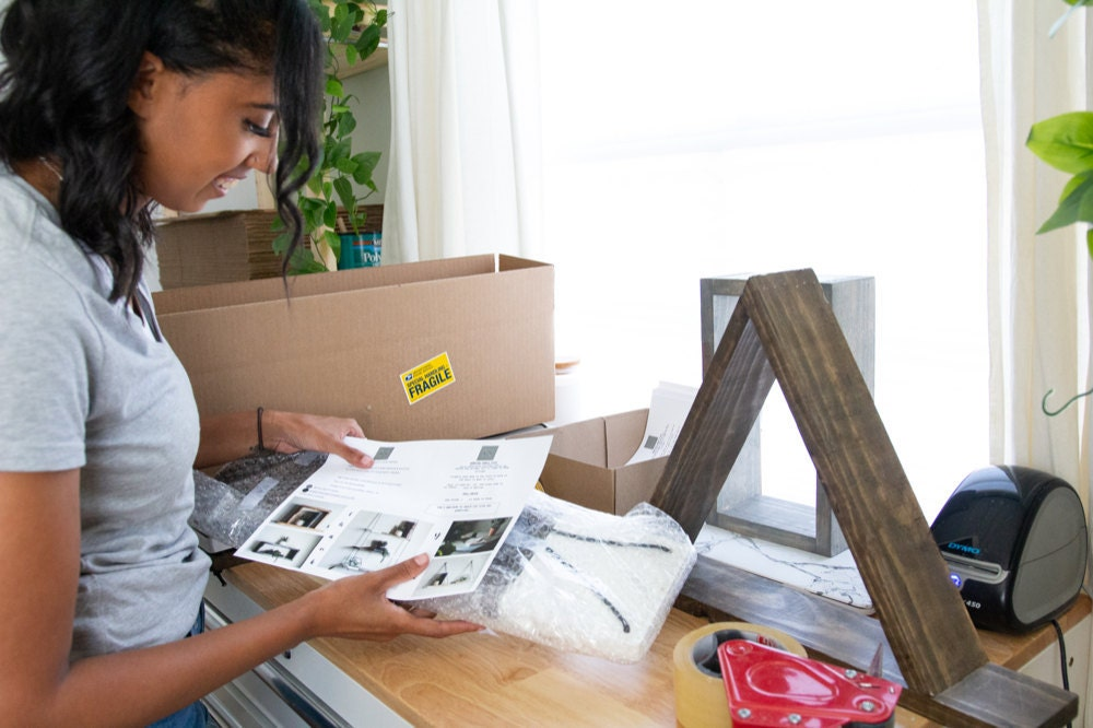 Ilana works on packing orders for shipment.