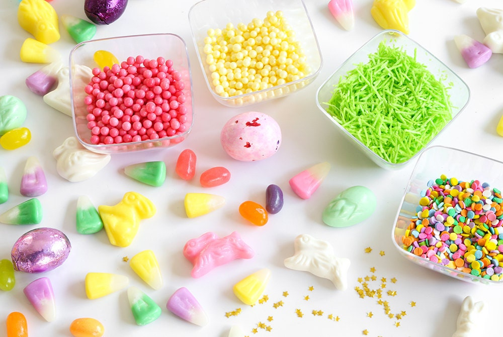 A neatly organized spread of assorted unwrapped Easter candies