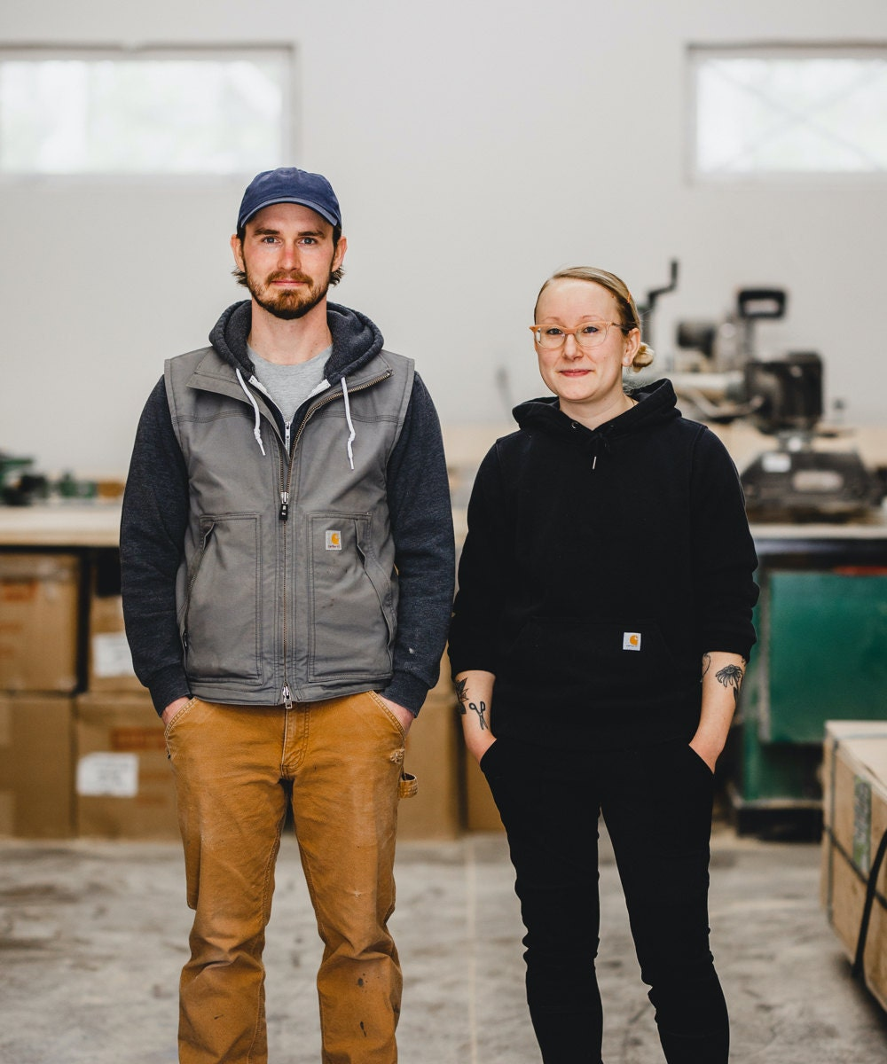 A portrait of WAAM Industries shop owners Andrew and Hanna in their Minnesota workshop.