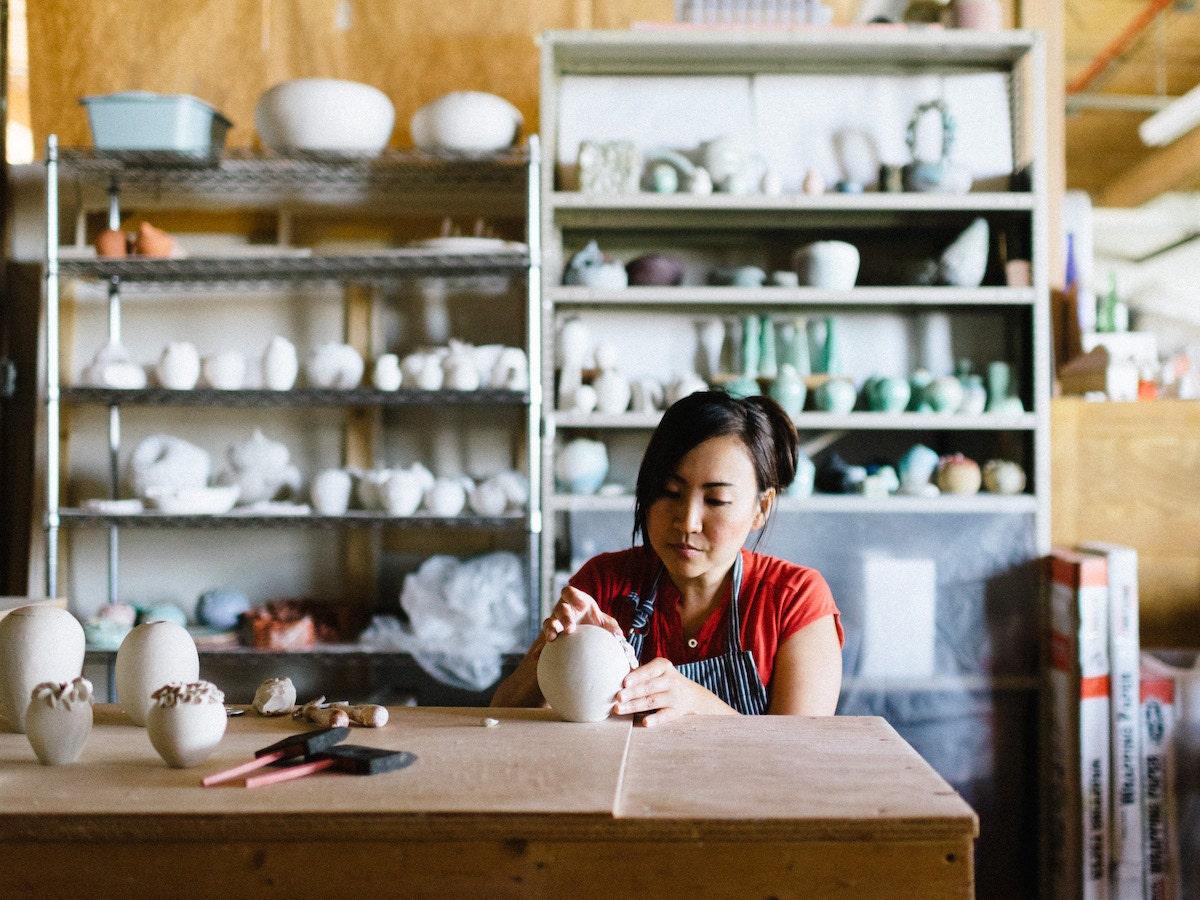Echo of Nature seller Yumiko Goto making pottery in her studio.