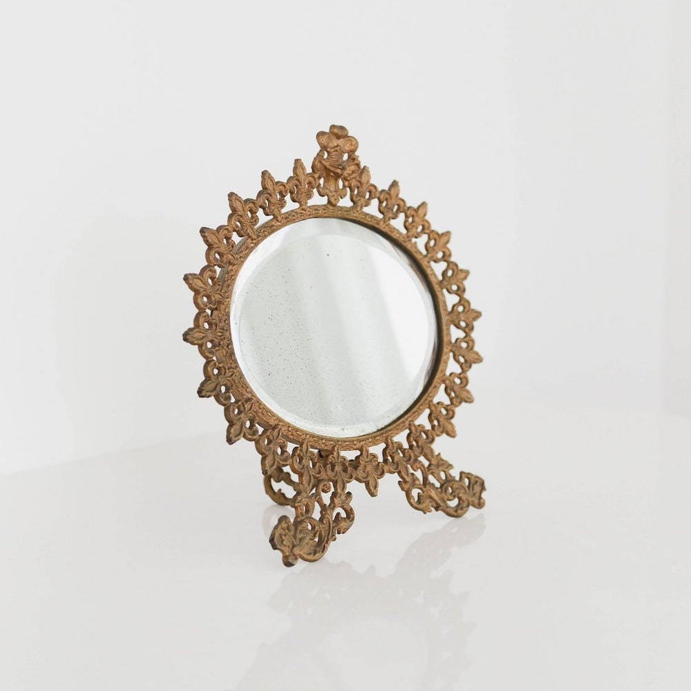 A vintage fleur de lis vanity mirror from Otherwise Shoppe