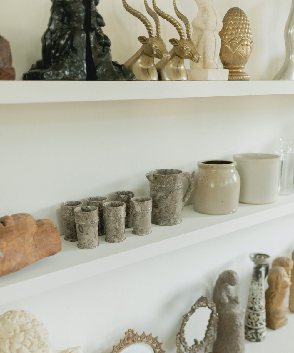 A closeup of the vintage objects on Mara's shelves.