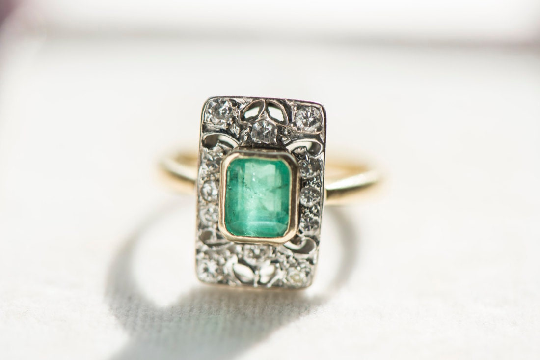 An emerald and diamond engagement ring from KK Vintage Collection