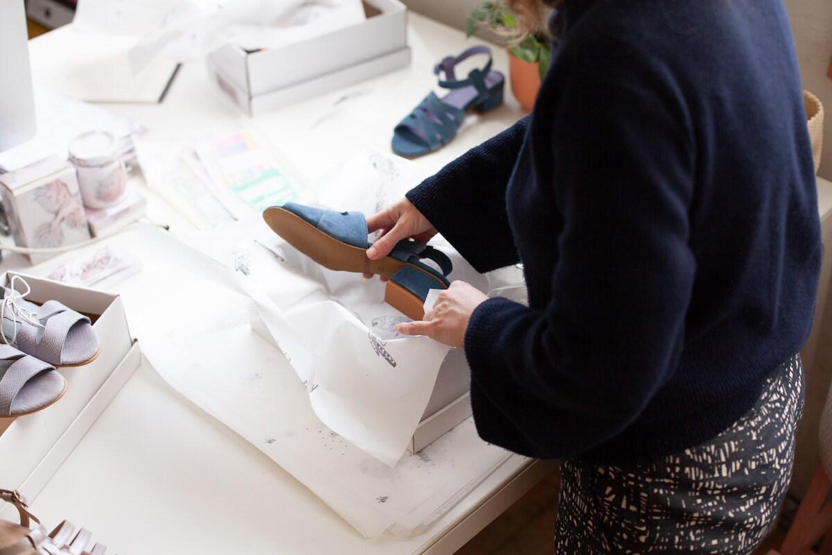 Hadas packs a pair of suede sandals