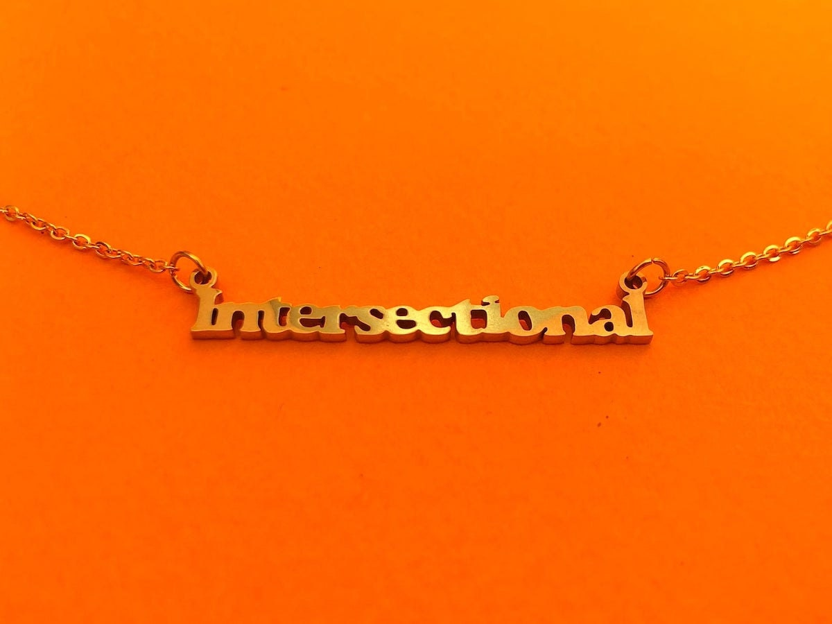 Intersectional feminist nameplate necklace from Brownie Points on Etsy