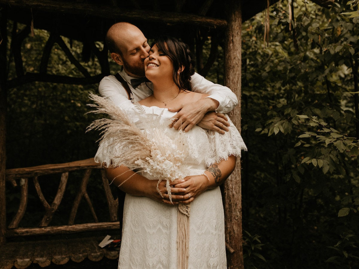 Sarah and Chris Schalago embrace on their wedding day.