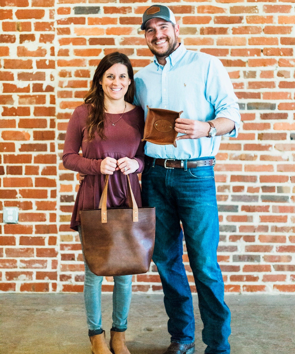 Portrait of Holtz Leather Co. shop owners Coleen and Rick Holtz.