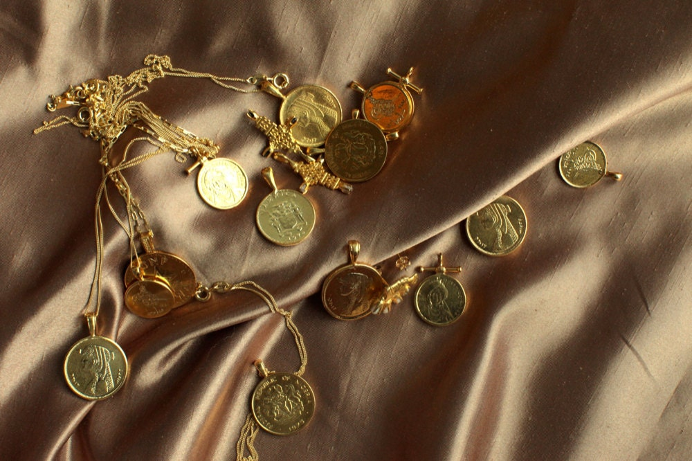 Assorted African gold coin necklaces from Omi Woods