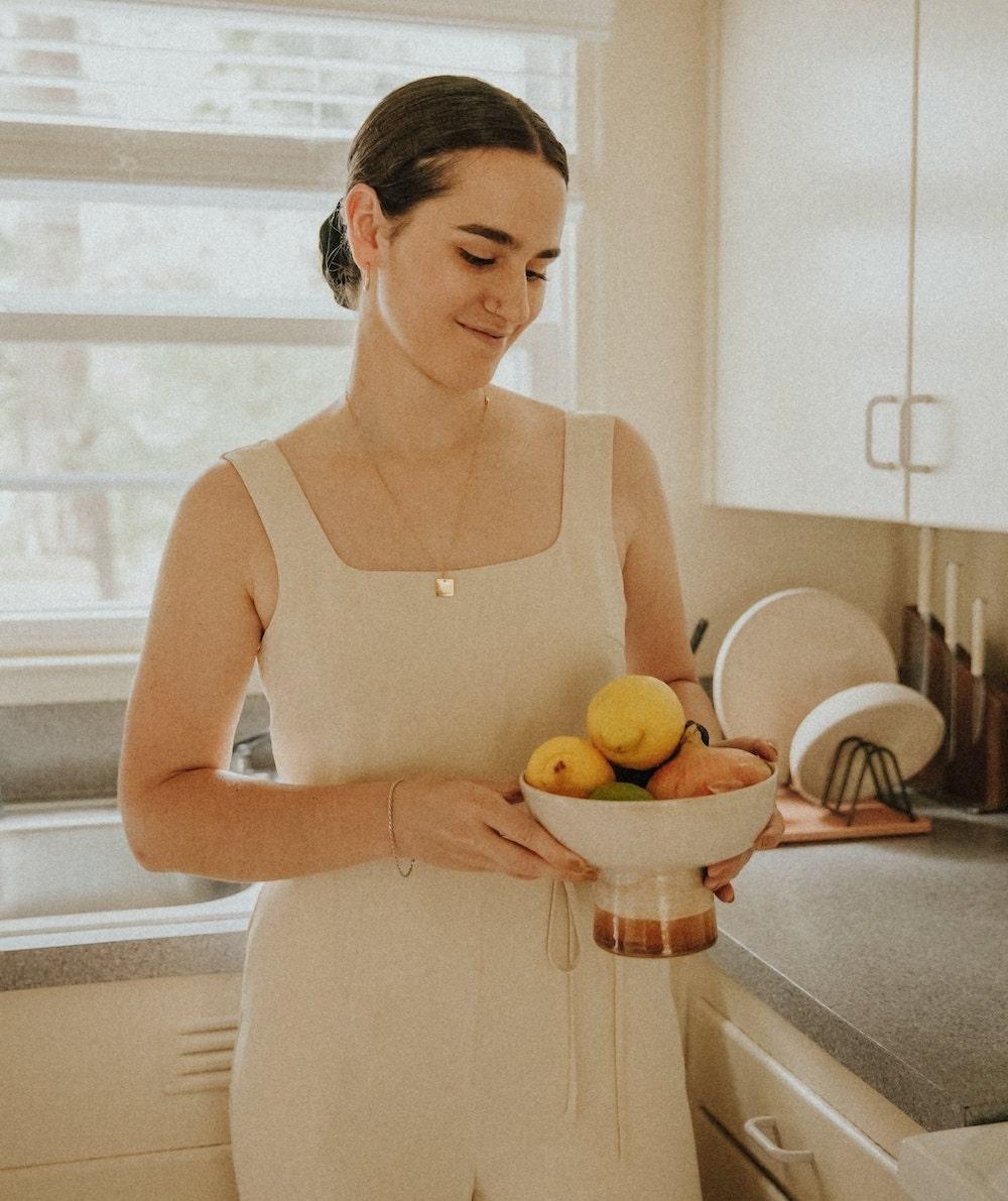 Tonya holding a fruit bowl