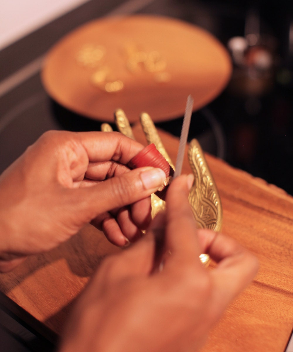 Ashley works on shaping a gold ring