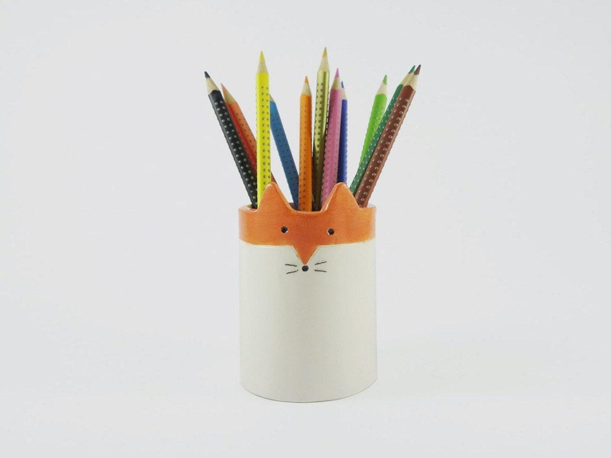 A fox-shaped pencil holder from Minky Moo Ceramics.