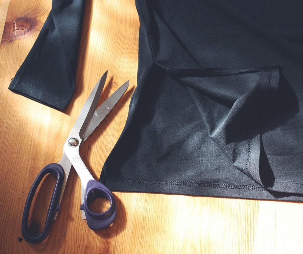 Cutting the seam of the shirt in a DIY bat costume