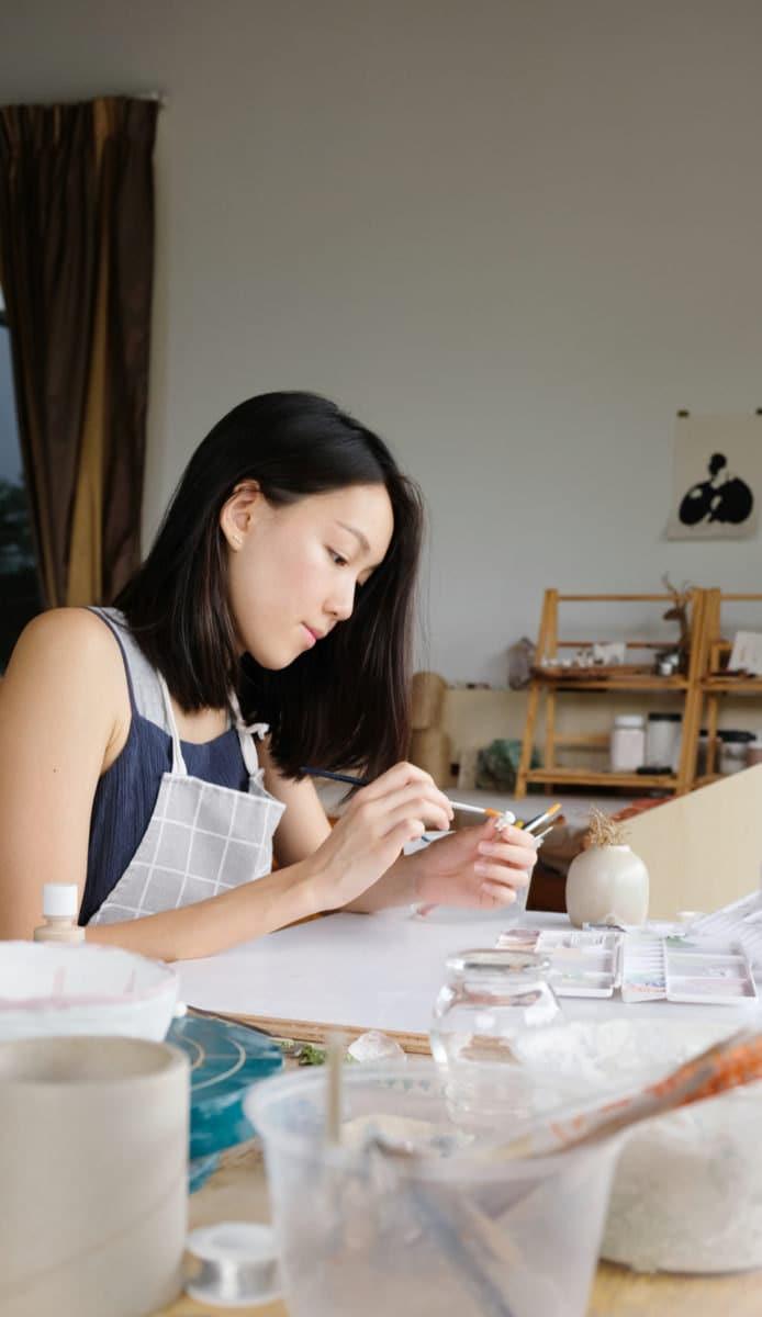 Chien Nie at work in her studio