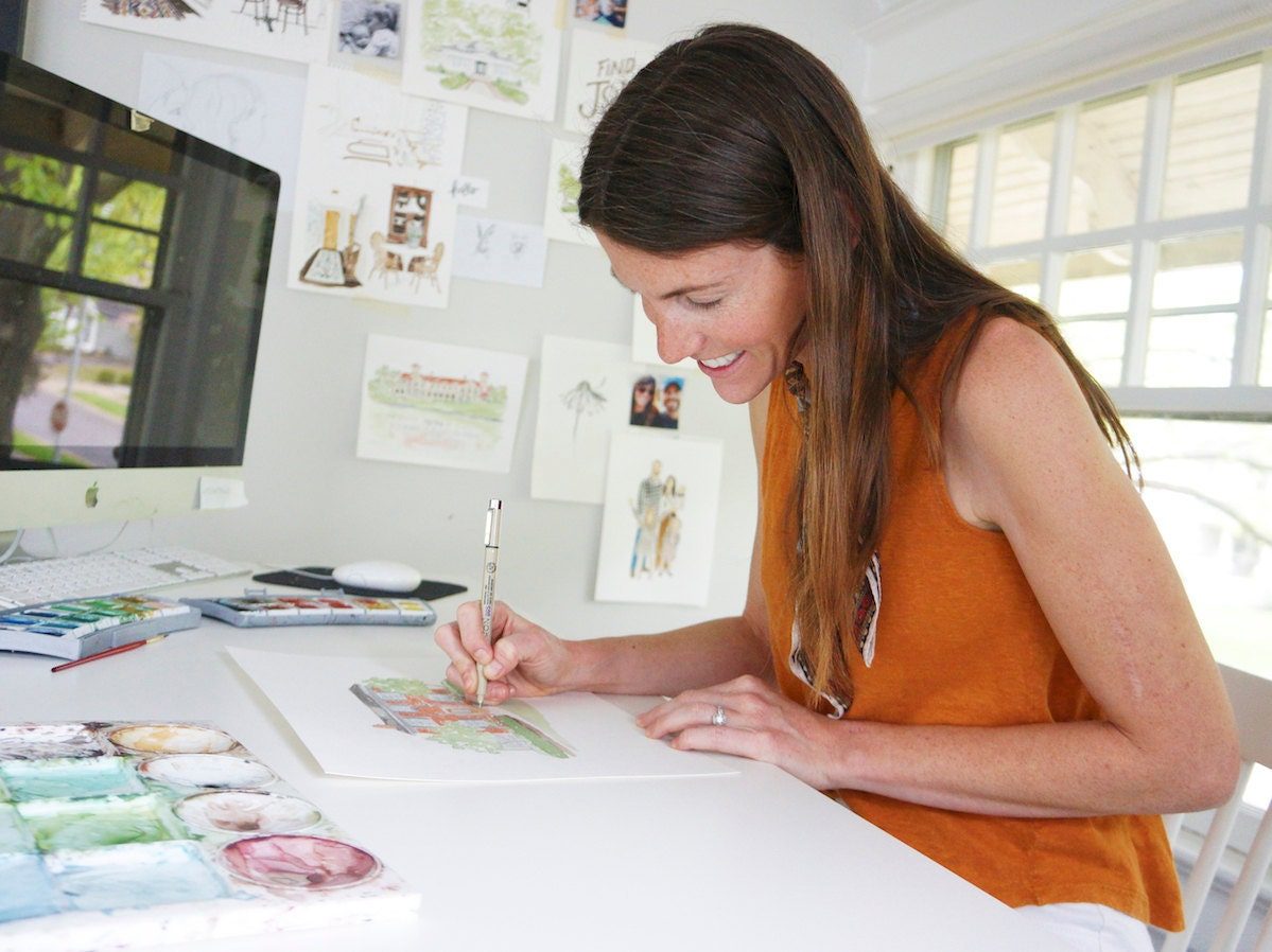 Samantha uses pen to add details to her watercolors