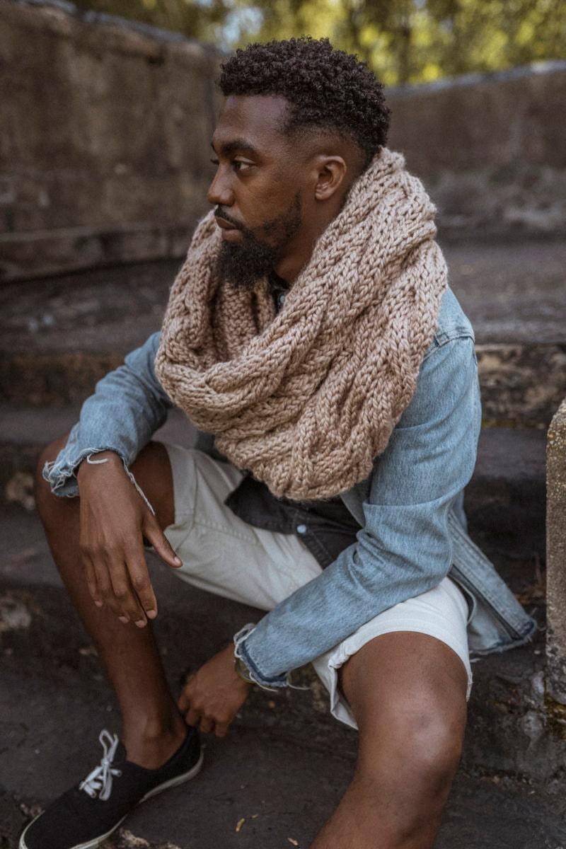 Nathan models a hand-knit cowl