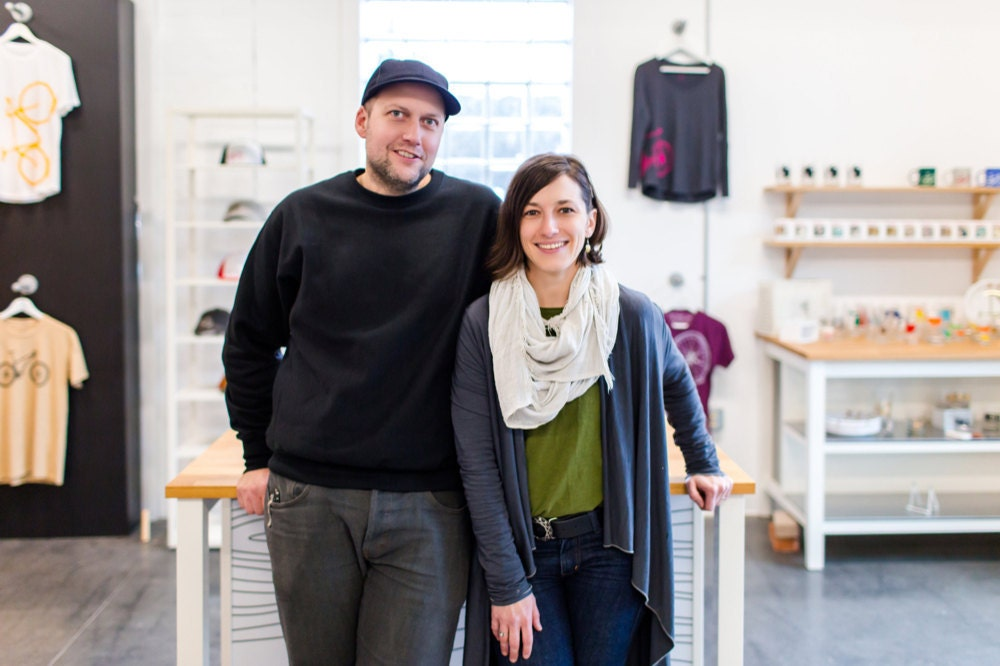 A portrait of Vital Industries shop owners and designers Brett Childs and Crystal Hanks Childs in their Wisconsin shop.