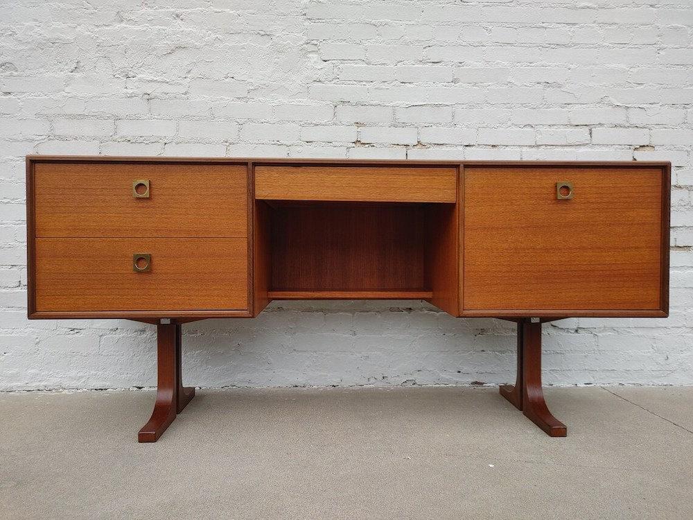 A vintage teak desk from Vintage Vault Tulsa on Etsy.