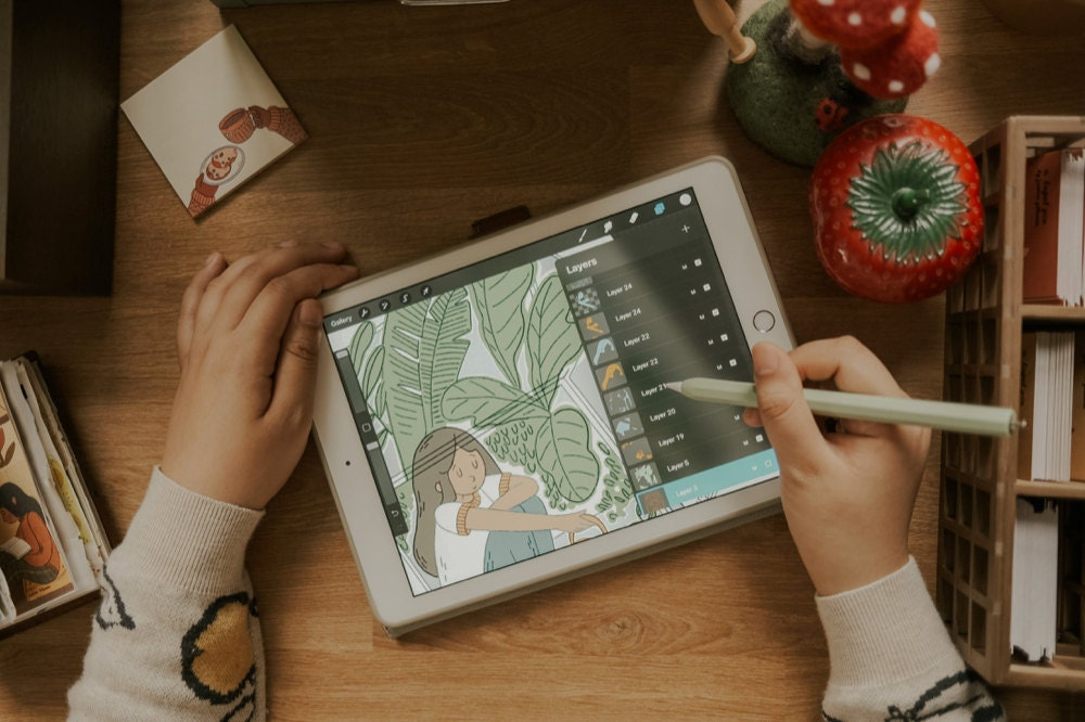 Justine drawing on her tablet.