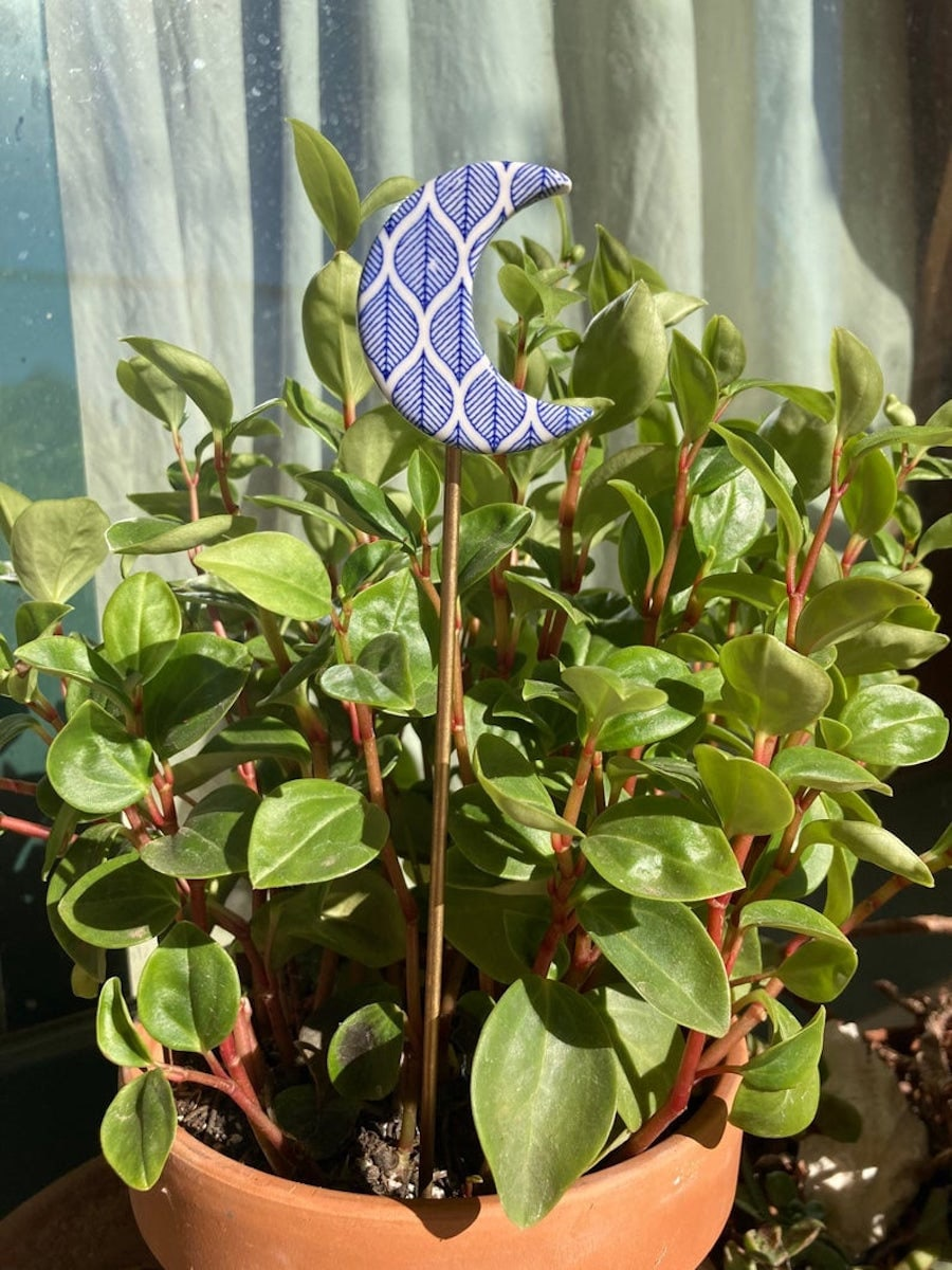 Crescent moon plant stake from Karing Vibes, on sale for summer at Etsy