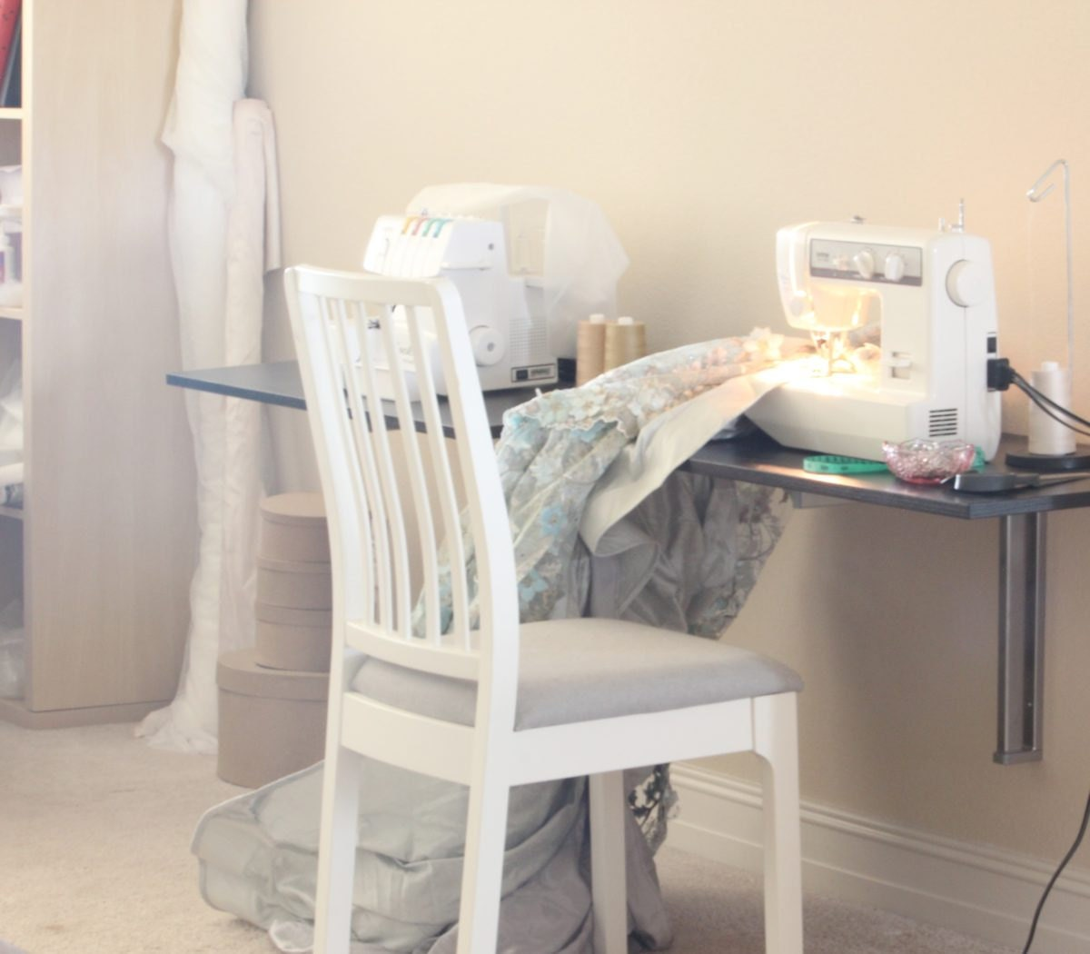 Smitha's workstation with a dusty blue bridal skirt in progress