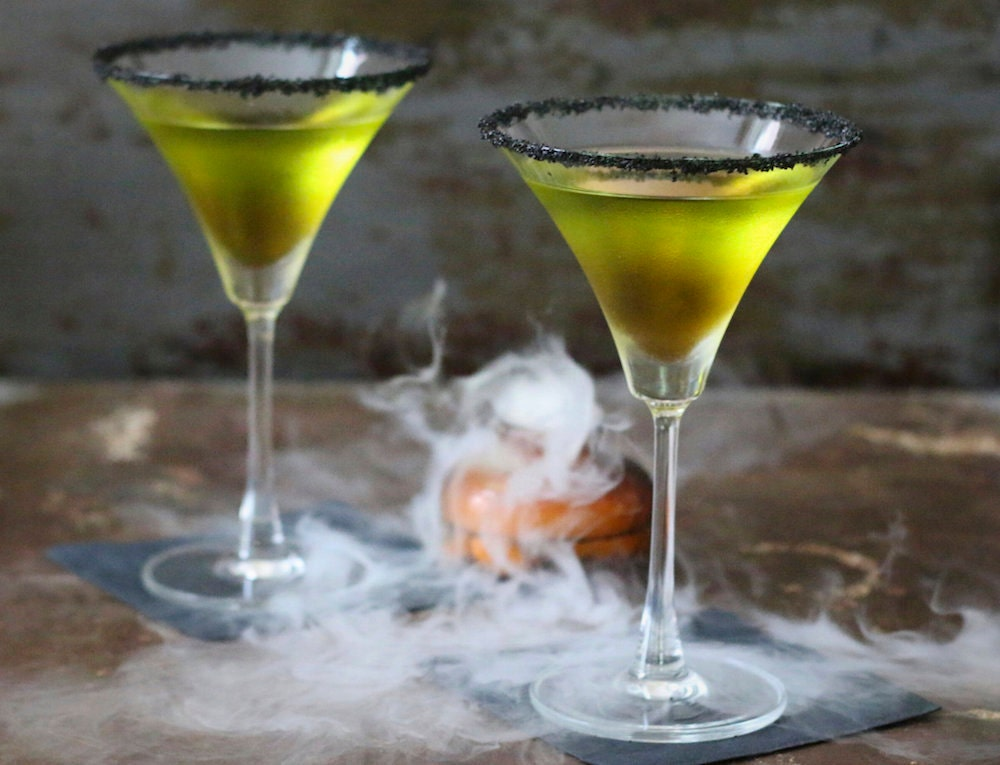 Green poison apple cocktails served in martini glasses