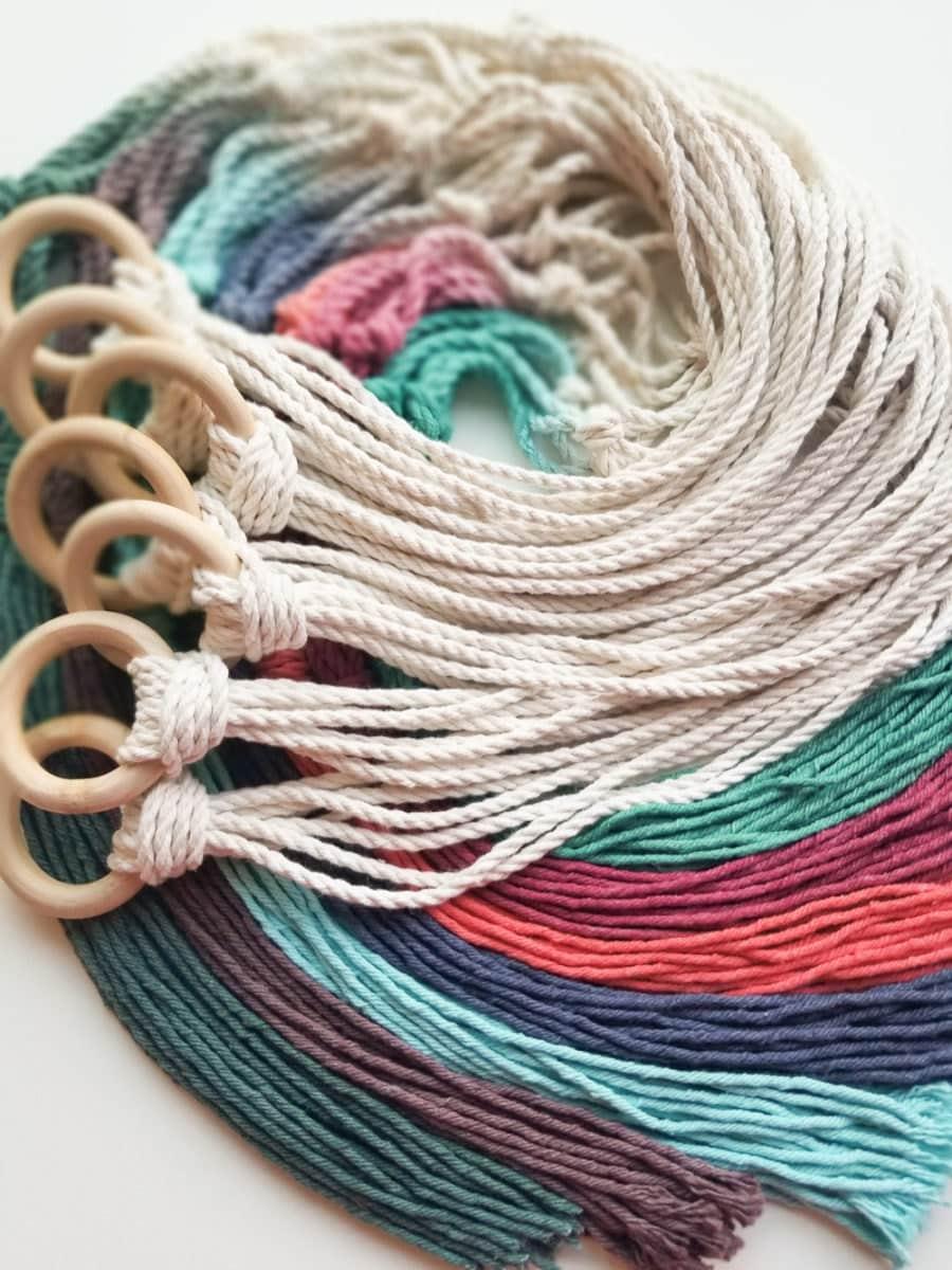 A rainbow of colorful fiber tassels.