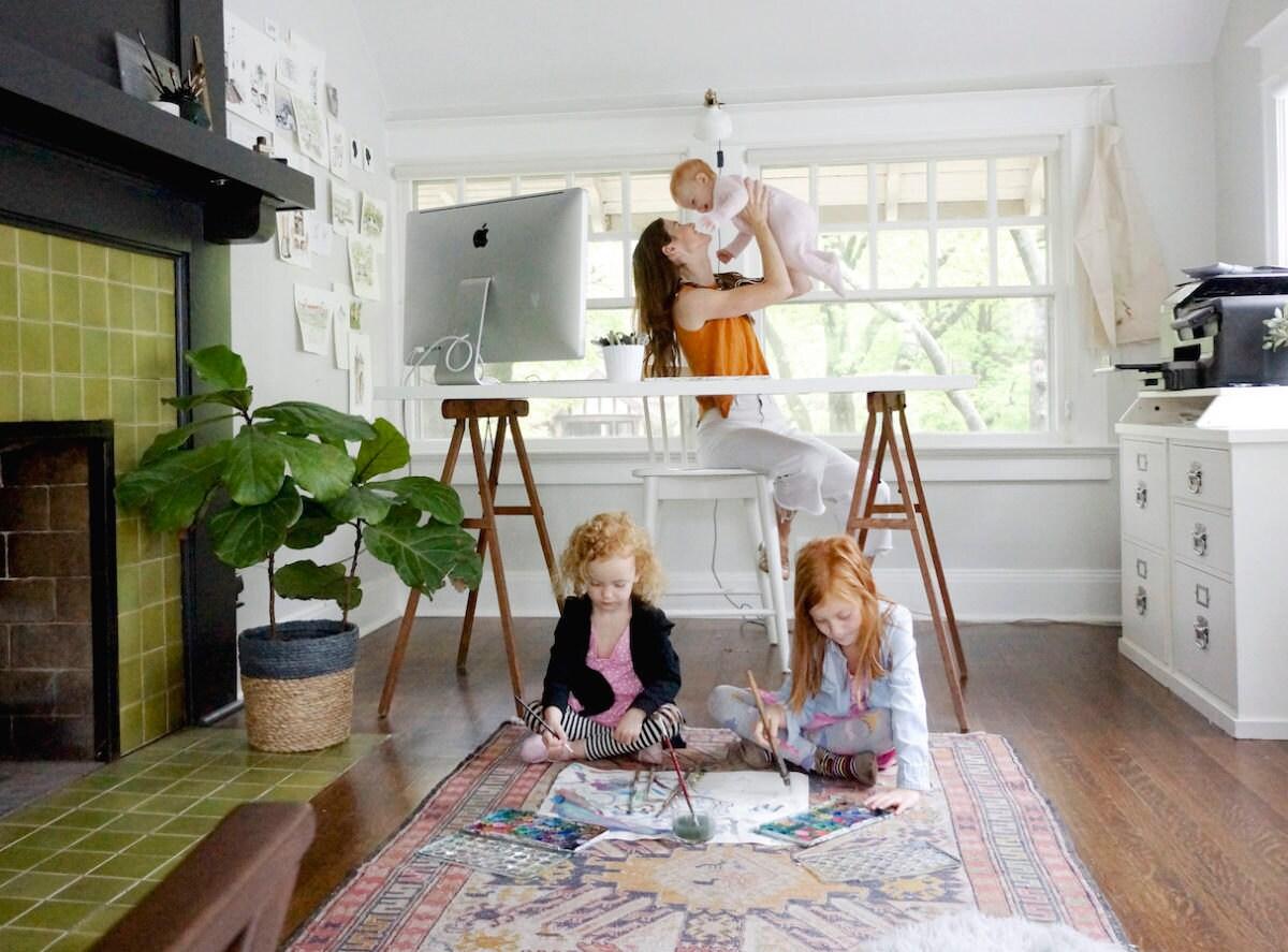 Samantha in her studio with her three children