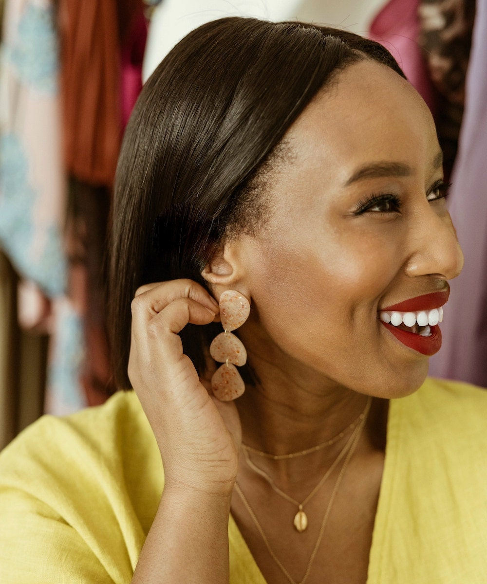 Shay wears a shimmery pair of dangly earrings