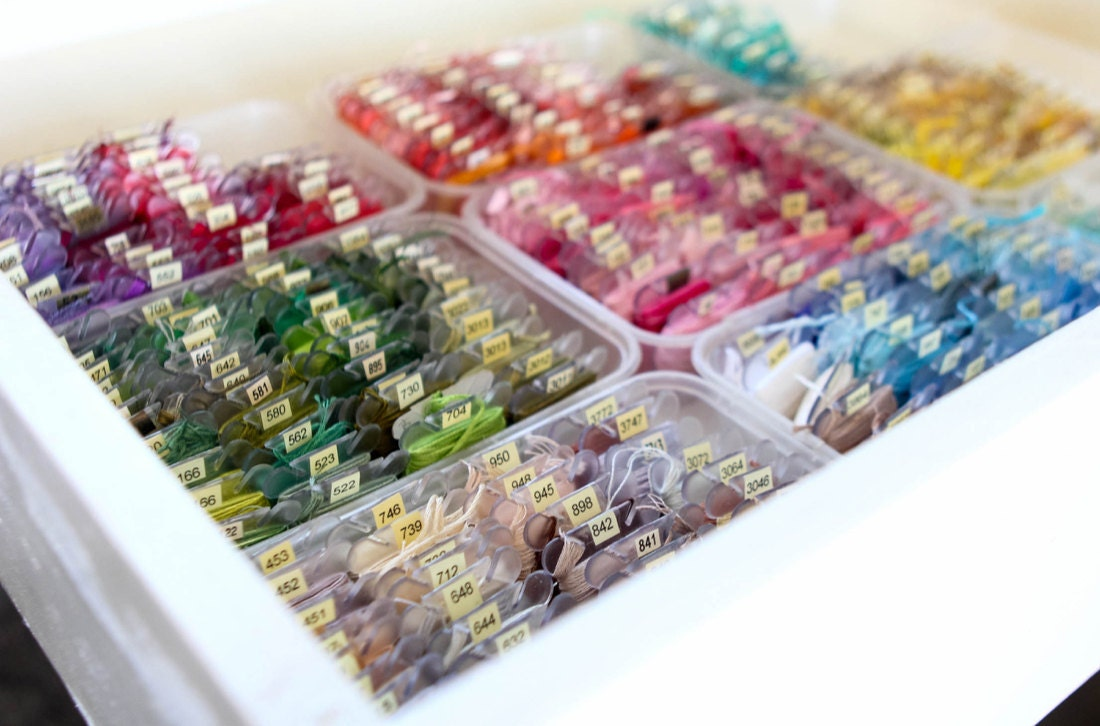 Ruby's extensive collection of embroidery floss, organized by color in a drawer