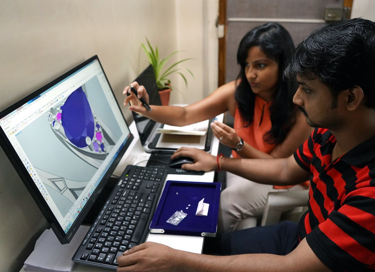 Madhulika and Abhishek discuss a 3D computer model of a new design