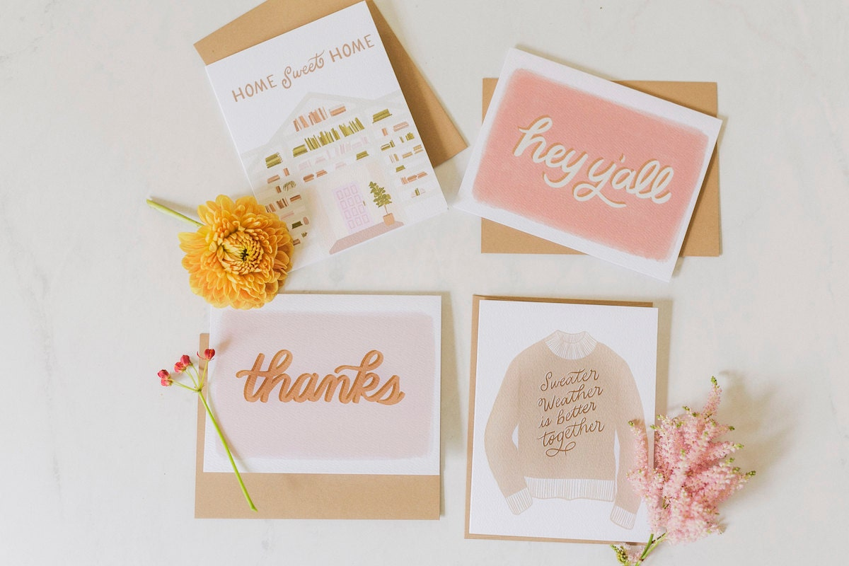 Assorted greeting cards from the A Beautiful Mess x Etsy collection