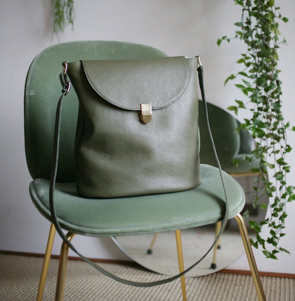 An olive green bucket bag from Alex Bender
