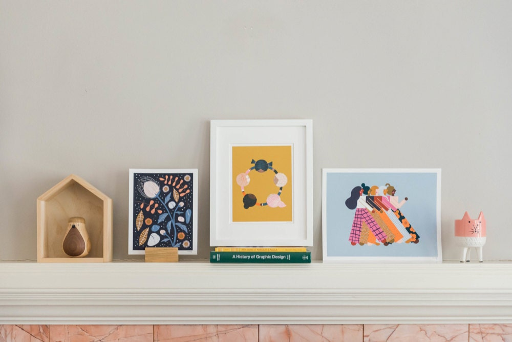 A mantel decorated with Meenal's colorful prints.