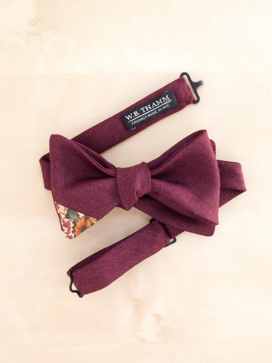 A red wool floral-tipped bow-tie from W.B. THAMM
