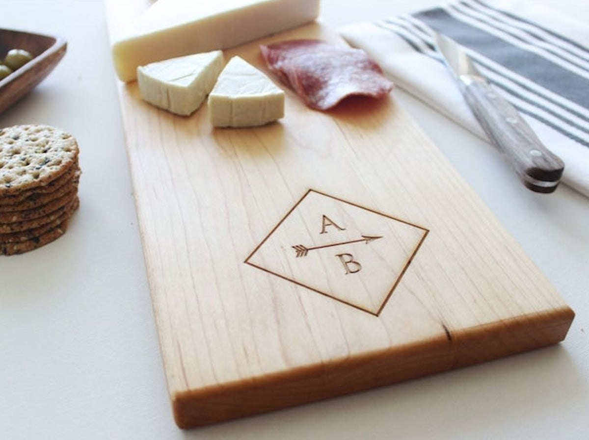 Custom cheese board from Sugar Tree Gallery, and other personalized Father's Day gifts from Etsy