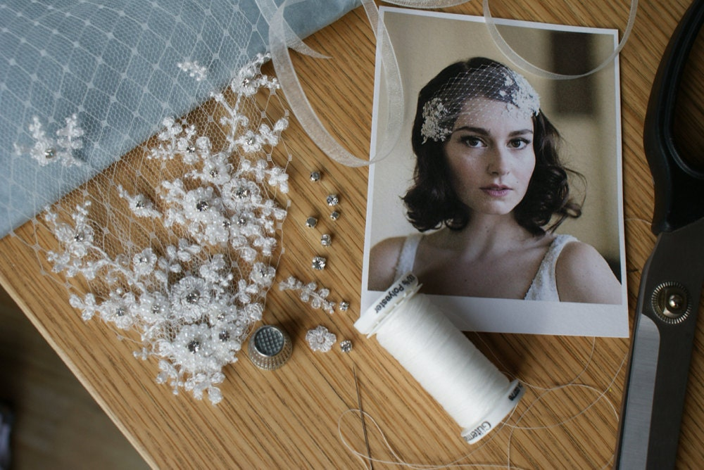 Beads, trimming, and string laid out on a desk before Rae transforms them into a bridal headpiece.