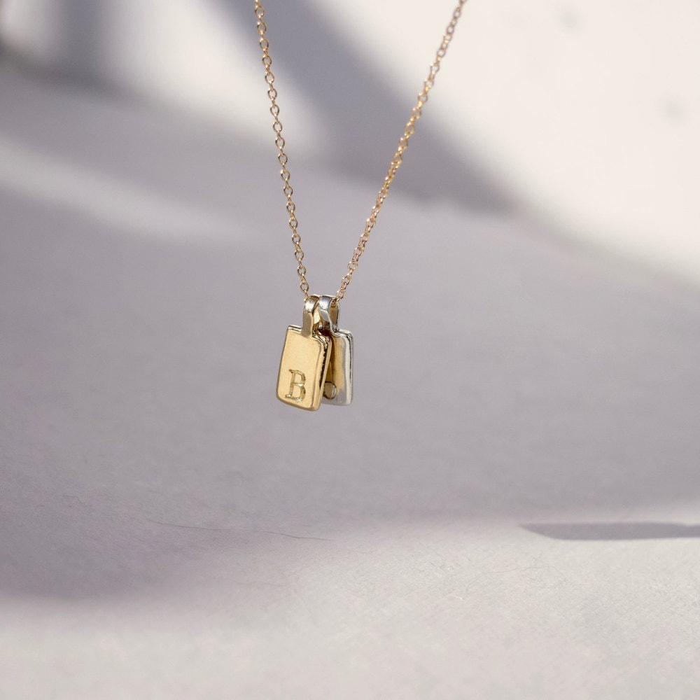 An initial tag necklace from Everli
