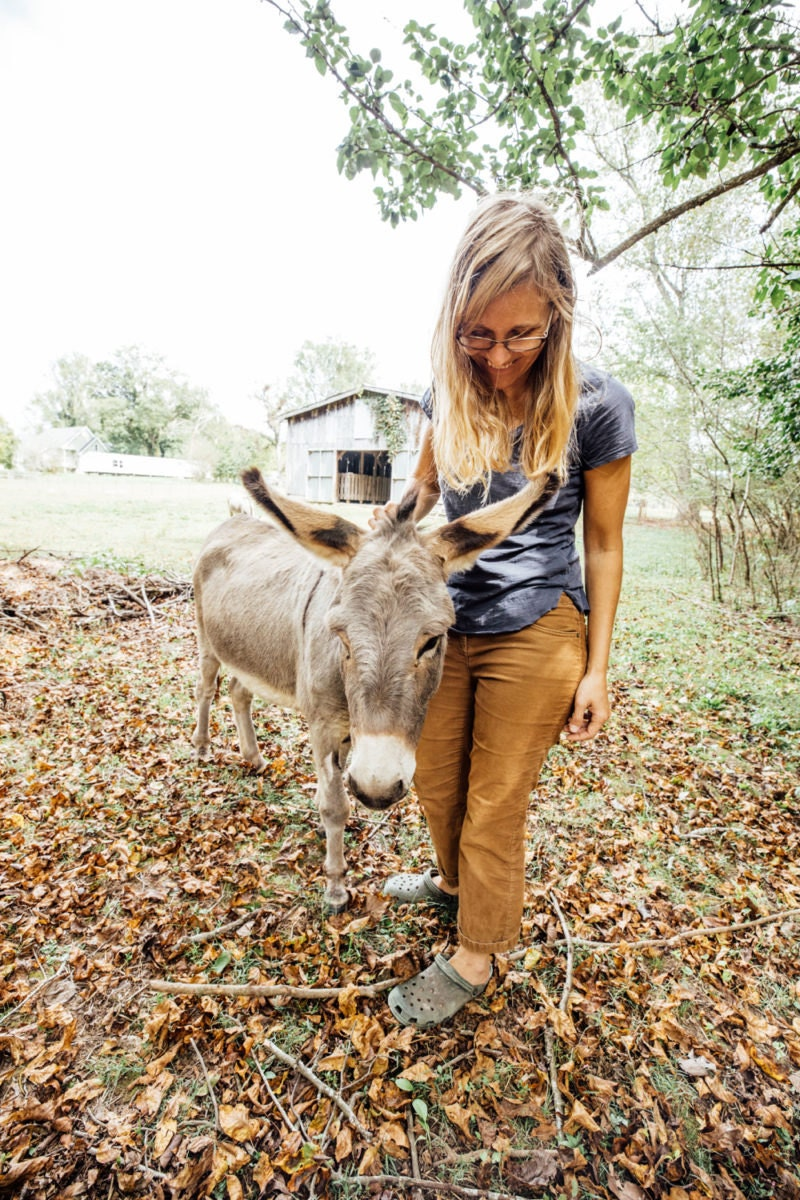 Kacie with one of her miniature donkeys