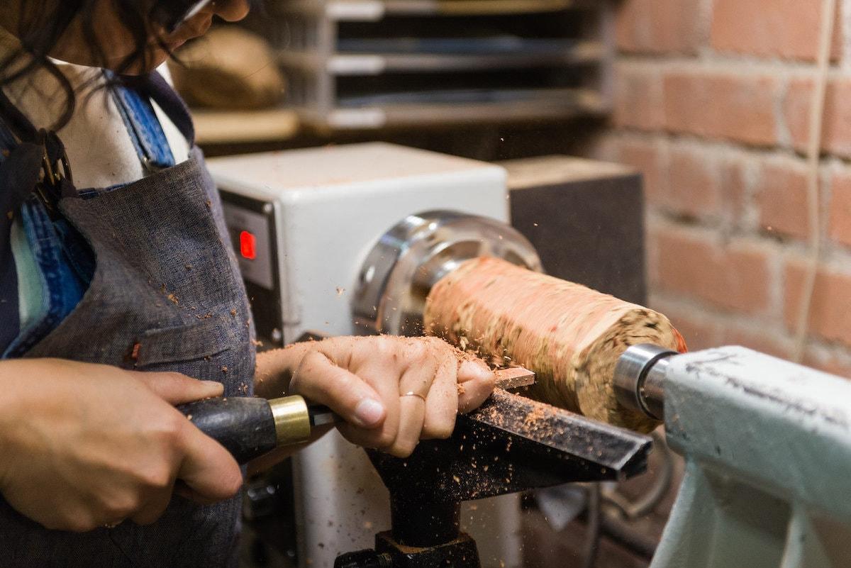 Melanie turns a piece of cork in her studio