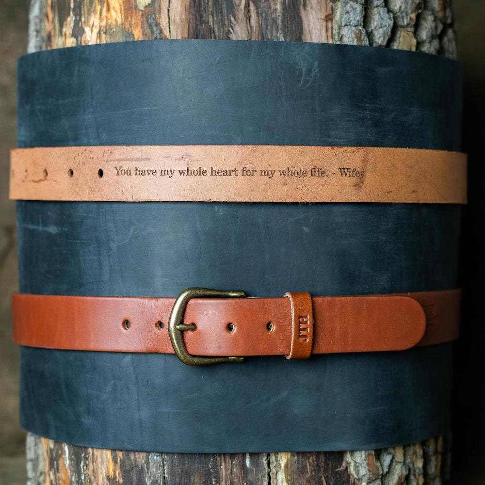 """A personalized leather belt from Holtz Leather Co. inscribed with the words """"You have my whole heart for my whole life. - Wifey"""" on the inside."""