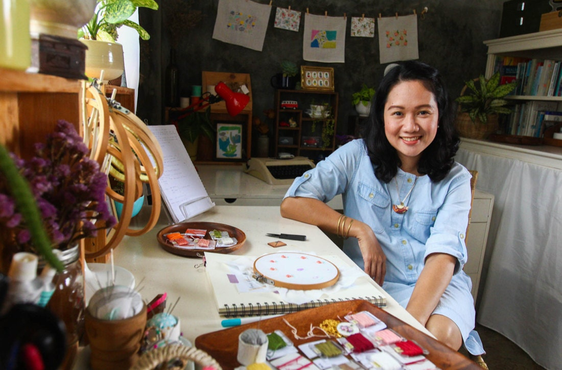 Portrait of embroidery artist Ruby Thursday More in her home studio