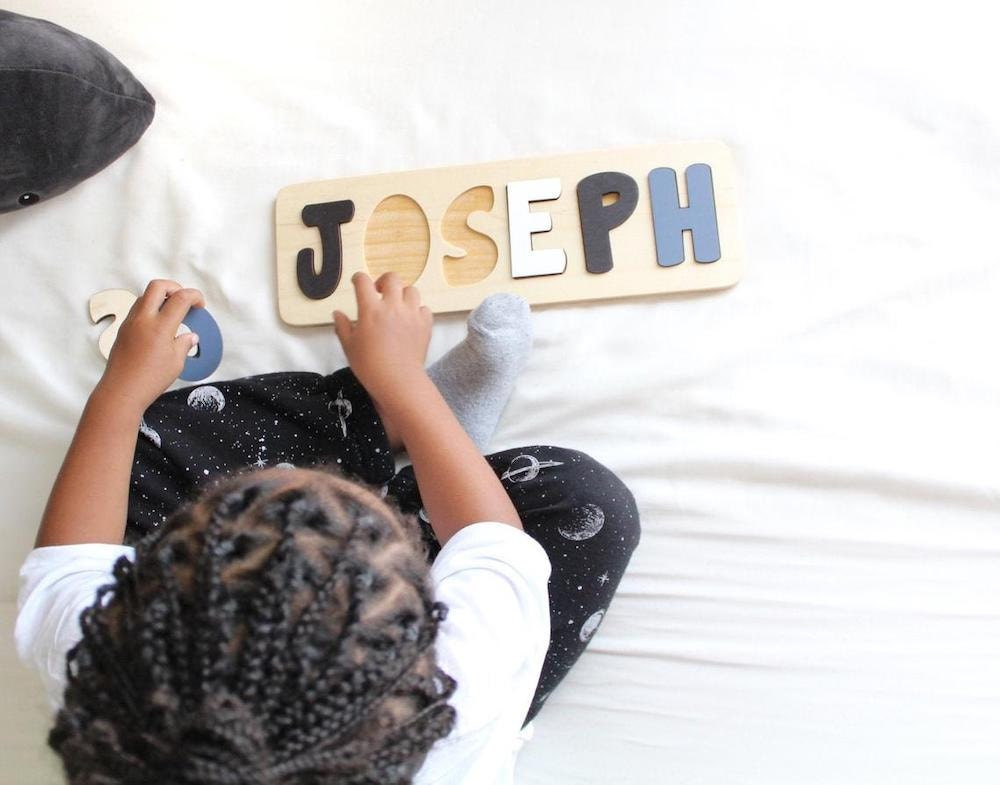 Personalized wooden name puzzle from Bloom Owl