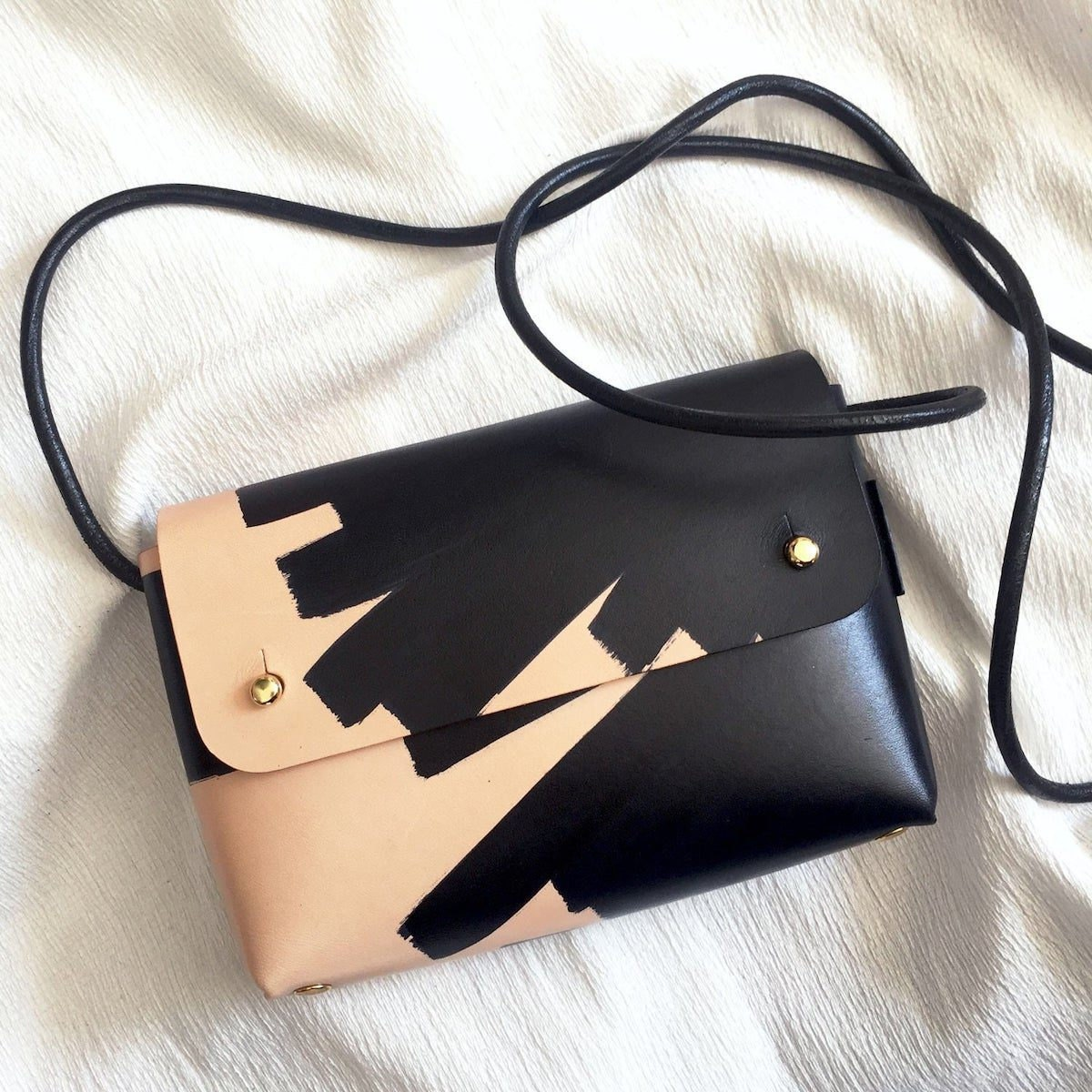 Hand-painted leather handbag from Klès