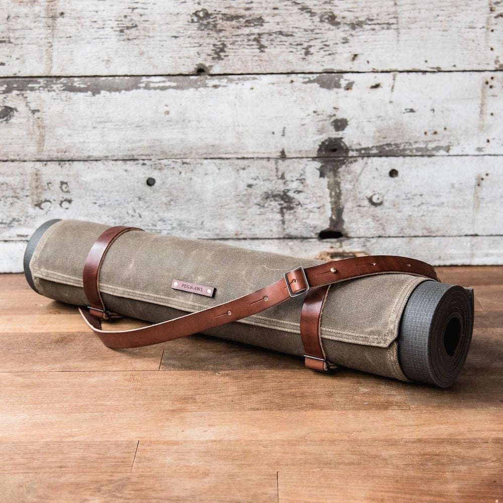 A waxed canvas yoga mat carrier from Peg and Awl