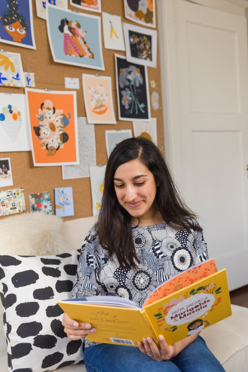 Meenal reading from one of her children's books