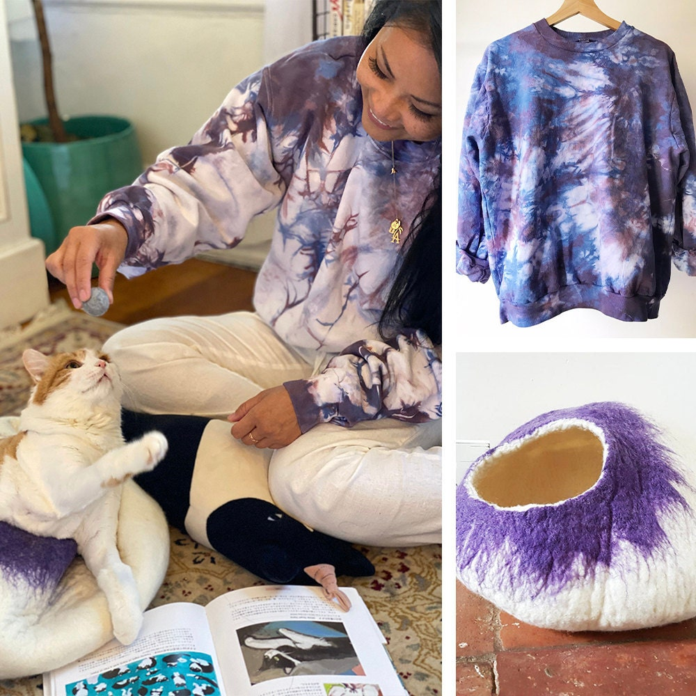 A collage of a woman and her cat modeling a matching tie-dye sweatshirt and purple cat bed.