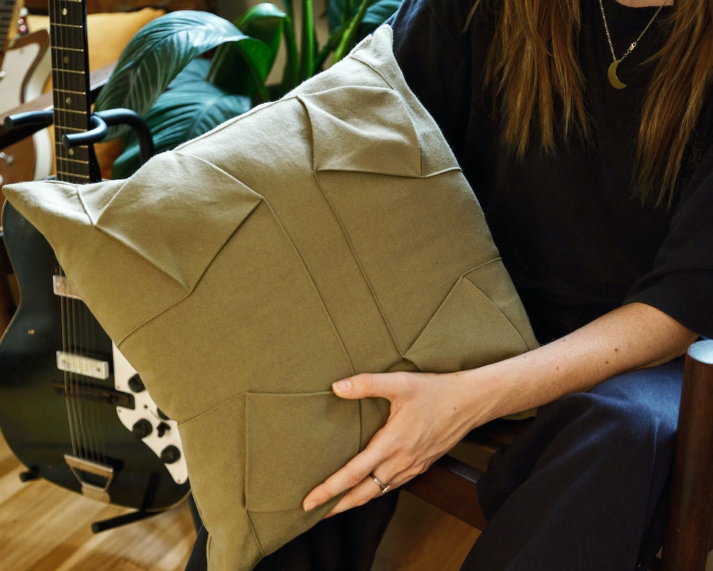 An origami-inspired canvas throw pillow cover from EL ARBOL DE CEREZO on Etsy.
