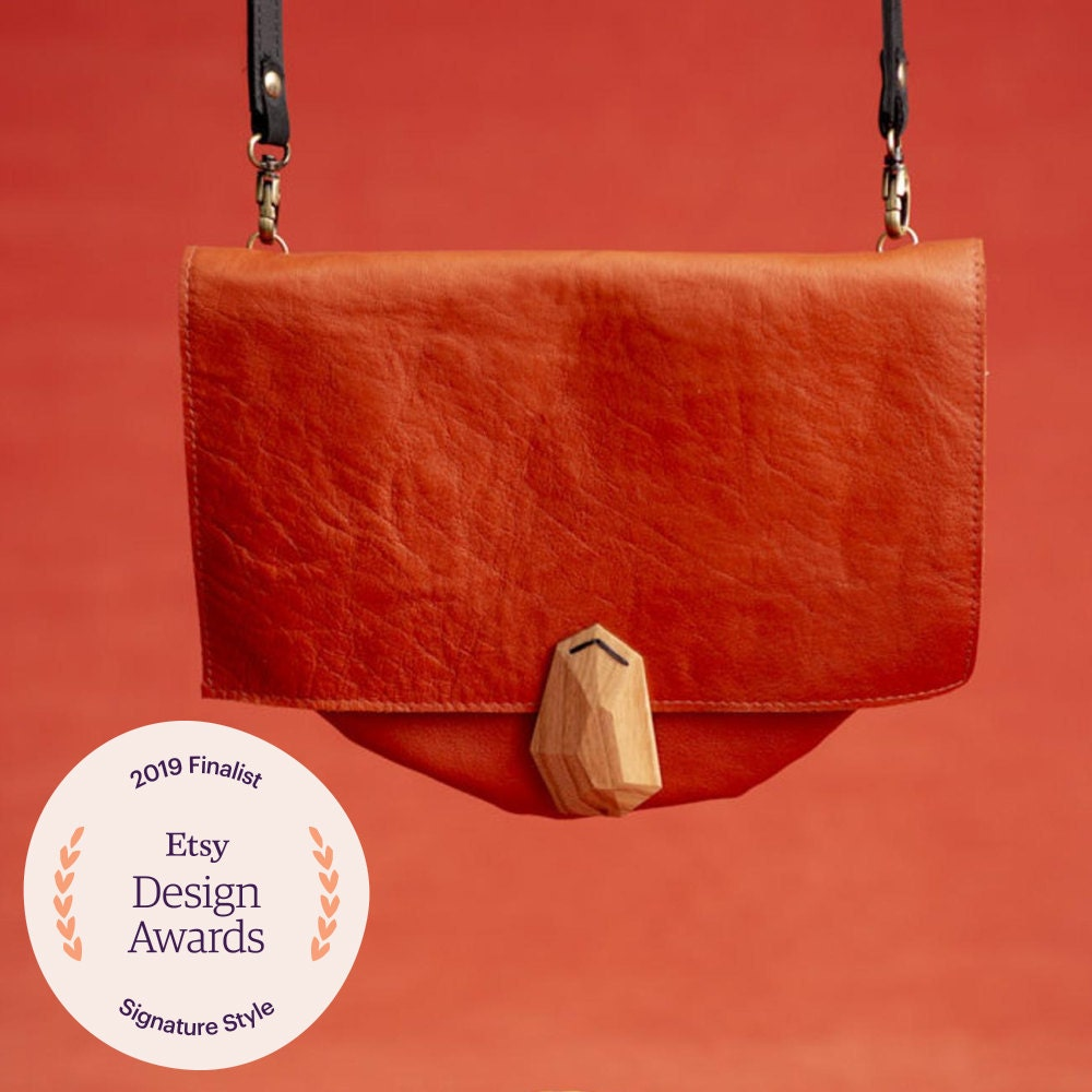 A coral leather purse from VEINAGE