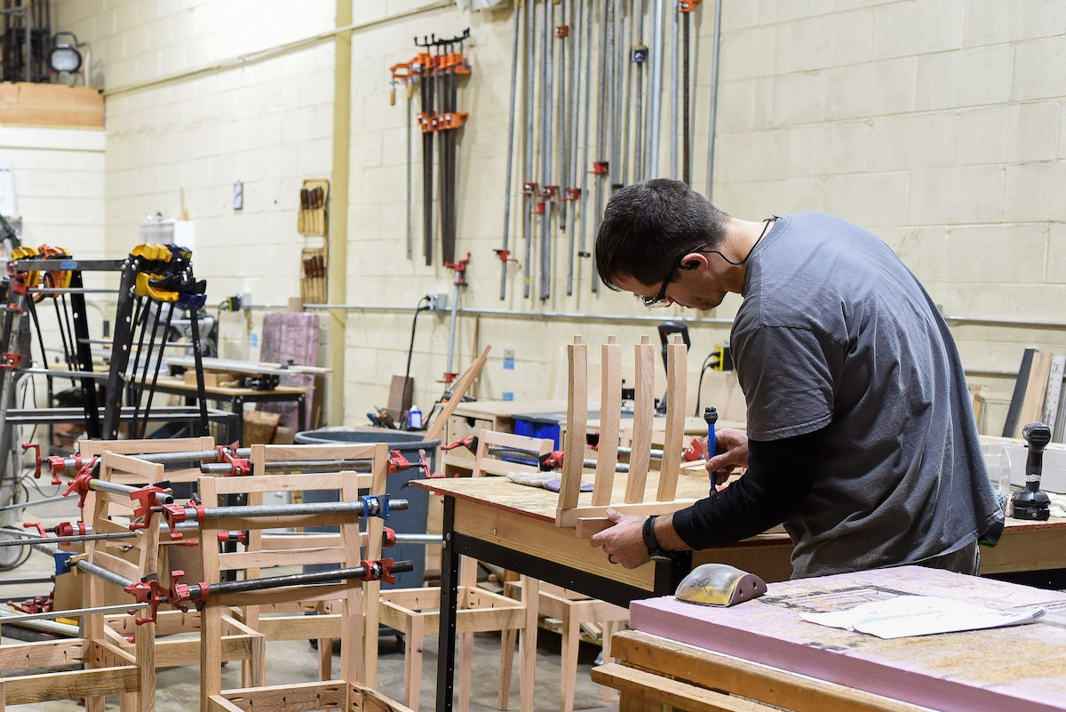 George at work on a chair in the What WE Make workshop