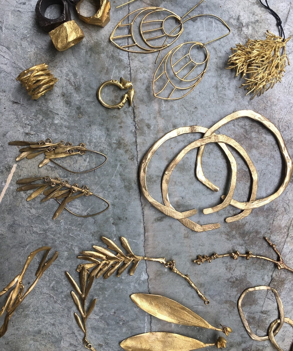 A flat lay of assorted nature-inspired jewelry from Mai Solorzano